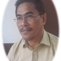Dr. Mansyur Radjab, M.Si